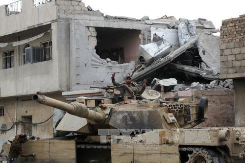 กลุ่มไอเอสใช้อาวุธเคมีในเมืองโมซูล ประเทศอิรัก - ảnh 1