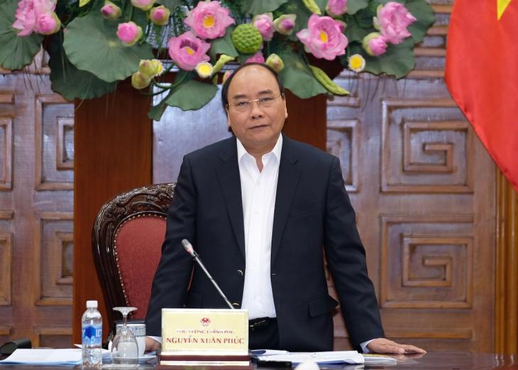 นายกรัฐมนตรี เหงวียนซวนฟุกประชุมกับผู้บริหารจังหวัดอานยางและลาวกาย - ảnh 1