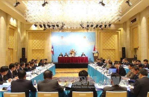 เวียดนาม-ลาวร่วมมือและแลกเปลี่ยนประสบการณ์ด้านการต่อต้านอาชญากรรม - ảnh 1