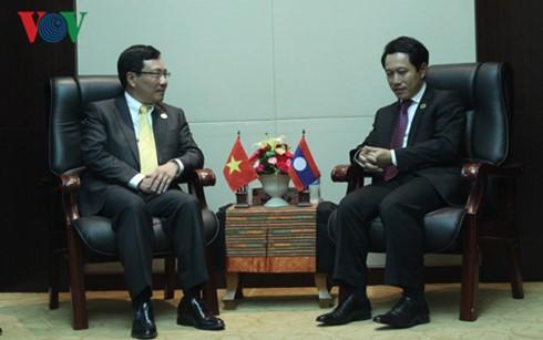 Aktivitäten des Vizepremierministers, Außenministers Pham Binh Minh in Laos - ảnh 1