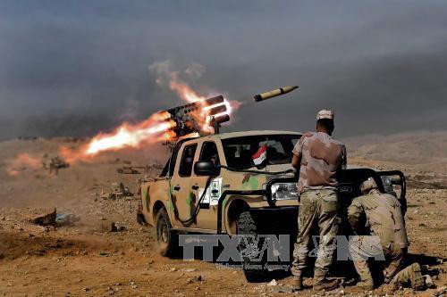 Erneute Gefechte zwischen der irakischen Armee und IS-Milizen in Mossul - ảnh 1