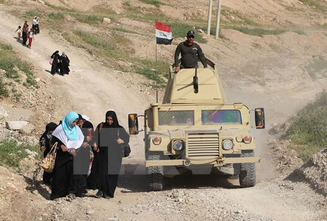 ບັນດາກຳລັງອີຣັກປົດປ່ອຍເຂດໃກ້ຄຽງຢູ່ທາງທິດຕາເວັນຕົກສ່ຽງເໜືອ Mosul - ảnh 1