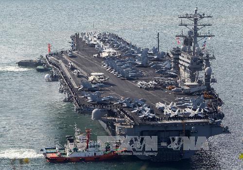 ຝູງກ່ຳປັ່ນເດີ່ນບິນ USS Nimitz ຂອງອາເມລິກາເລີ່ມຕົ້ນບັ້ນຮົບຕ້ານ IS ຢູ່ຊີຣີ,ອິຣັກ - ảnh 1