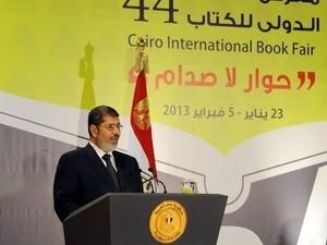 ชาวอียิปต์เดินขบวนสนับสนุนประธานาธิบดี โมฮัมเหม็ด มอร์ซี - ảnh 1