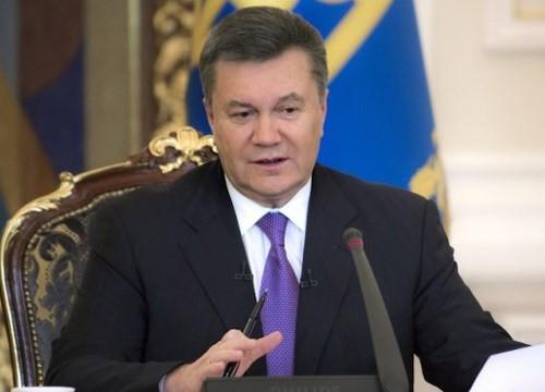 ประธานาธิบดียูเครนตำหนิการชุมนุมประท้วงคือการกระทำที่รุนแรง - ảnh 1