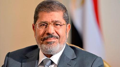 อียิปต์เลื่อนการดำเนินคดีอดีตประธานาธิบดี โมฮัมเหม็ด มอร์ซี  - ảnh 1