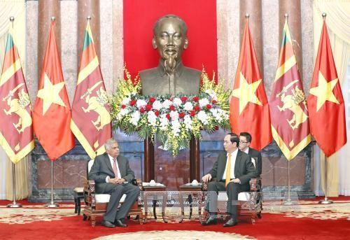 เลขาธิการใหญ่พรรคคอมมิวนิสต์เวียดนามและประธานประเทศเวียดนาม ให้การต้อนรับนายกรัฐมนตรีศรีลังกา  - ảnh 2