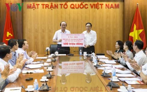 กิจกรรมสนับสนุนและช่วยเหลือประชาชนที่ประสบอุทกภัยในเขตเขาภาคเหนือเวียดนาม - ảnh 1