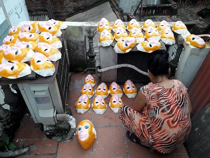 ผู้ที่อนุรักษ์อาชีพทำหน้ากากกระดาษของกรุงฮานอย - ảnh 5