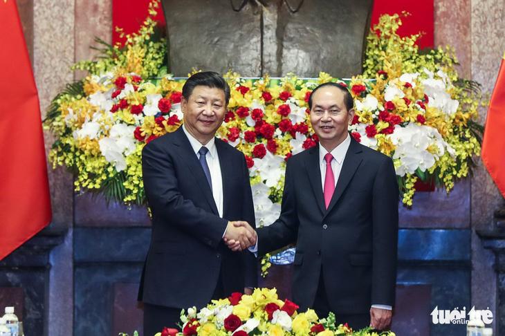 ประธานประเทศ เจิ่นด่ายกวาง เจรจากับเลขาธิการใหญ่และประธานประเทศจีน สีจิ้นผิง - ảnh 1