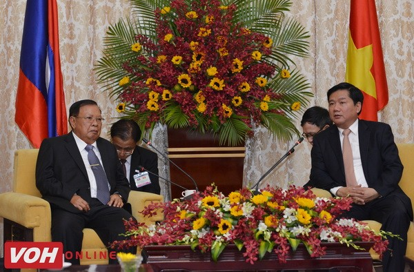 Laos's Party General Secretary and President visits HCM city - ảnh 1