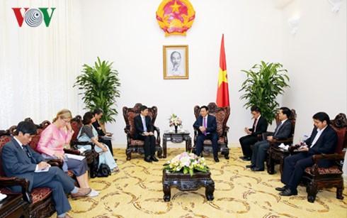 越南政府副总理王庭惠会见联合国助理秘书长徐浩良 - ảnh 1