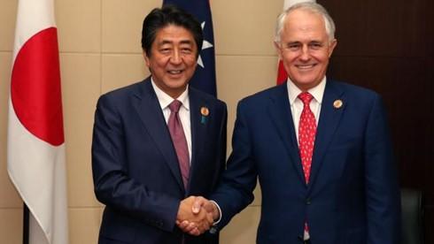 日本首相安倍访问澳大利亚 - ảnh 1