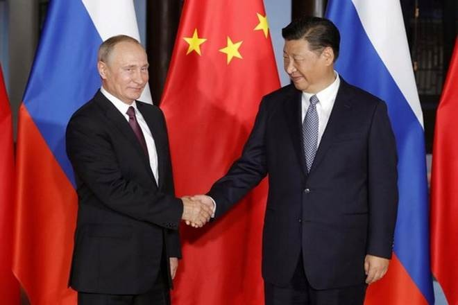 中国与俄罗斯加强在国际和地区问题上的合作 - ảnh 1