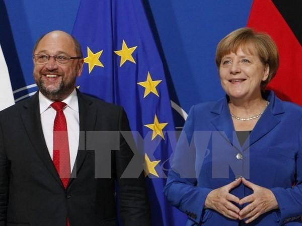 Allemagne: Merkel et les sociaux-démocrates se rapprochent peu à peu - ảnh 1