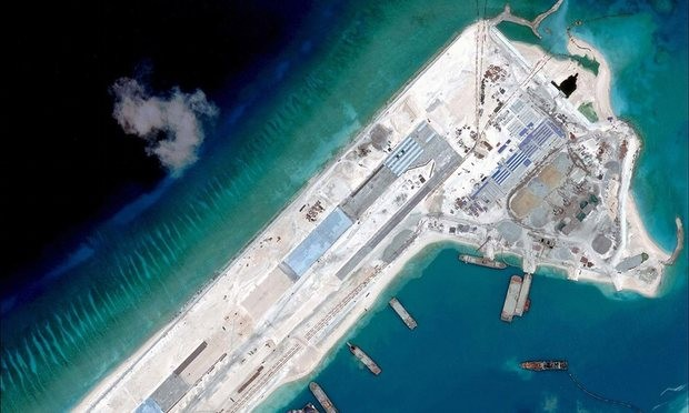 China defiantly deploys military aircraft to Fiery Cross Reef  - ảnh 1