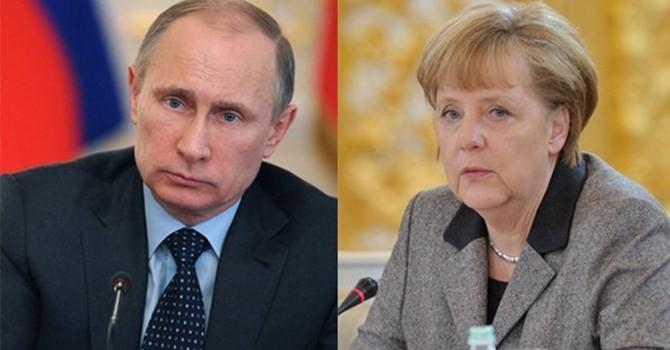 Лидеры ФРГ и РФ выступили за скорейшее начало прямых переговоров на Украине - ảnh 1