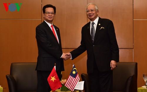 Нгуен Тан Зунг встретился с премьером Малайзии и президентом Филиппин - ảnh 1