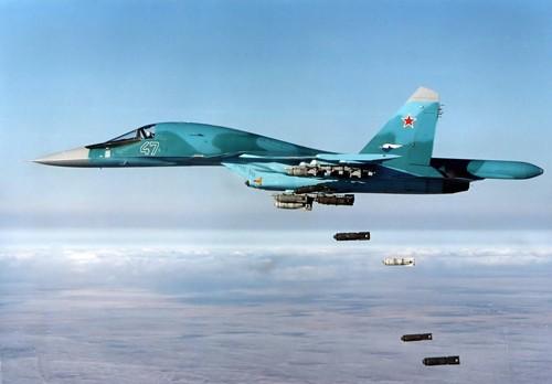 Россия нанесла первые авиаудары по позициям ИГ в Сирии - ảnh 1