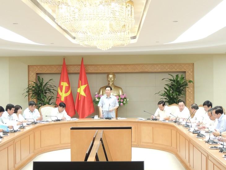 Vuong Dinh Huê préside la réunion du comité en charge des programmes  nationaux ciblés - ảnh 1