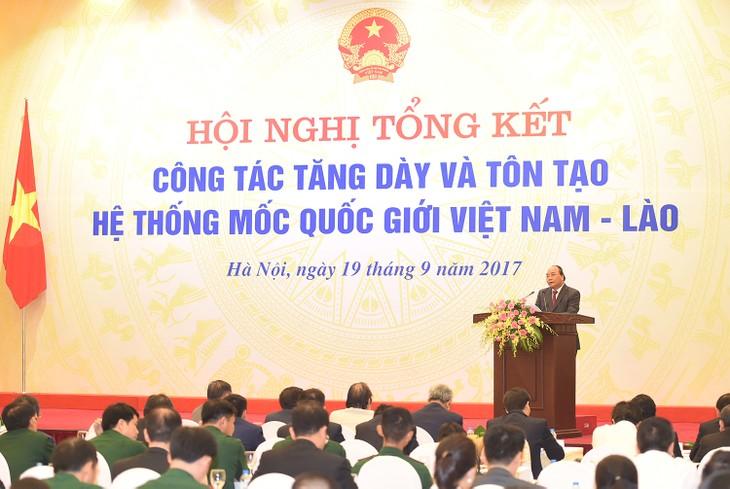 Conférence-bilan de la consolidation des bornes frontalières Vietnam-Laos - ảnh 1