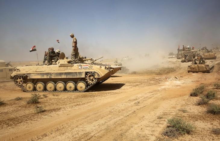 Irak: les forces gouvernementales avancent - ảnh 1