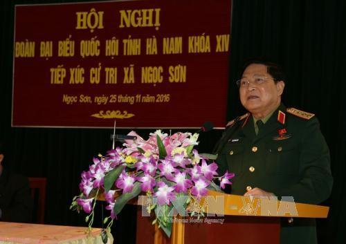រដ្ឋមន្ត្រីការពារប្រទេសលោក Ngo Xuan Lich ទទួលជួបជាមួយអ្នកបោះឆ្នោតខេត្ត Ha Nam - ảnh 1