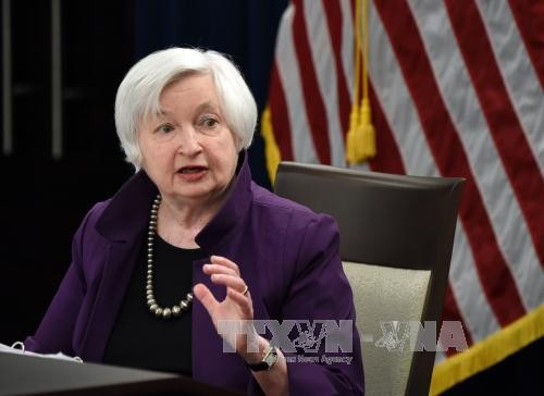 ФРС повысила базовую процентную ставку до 1-1,25% - ảnh 1