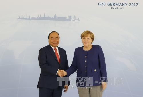 Состоялись переговоры между премьером Вьетнама и канцлером Германии - ảnh 1