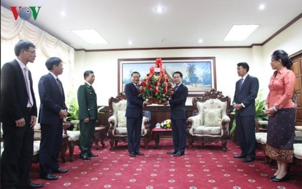 Поздравительные телеграммы по случаю 55-летия со дня установления дипотношений между СРВ и Лаосом - ảnh 1