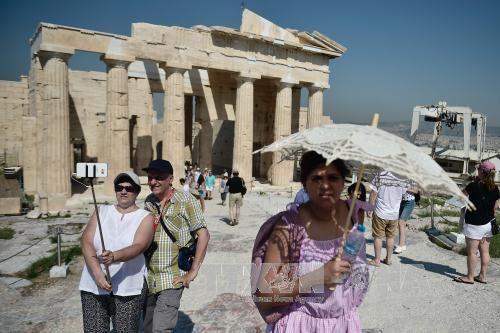 МВФ одобрил новый кредит Греции в размере 1,6 млрд евро - ảnh 1