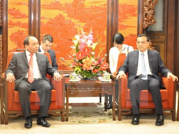 Nguyen Xuan Phuc rencontre le Premier ministre chinois - ảnh 1