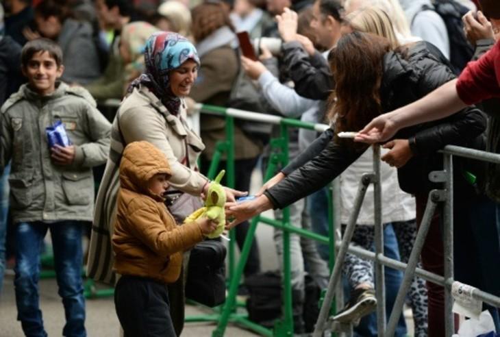Crise des migrants: arrivée au Royaume-Uni des premiers réfugiés syriens - ảnh 1