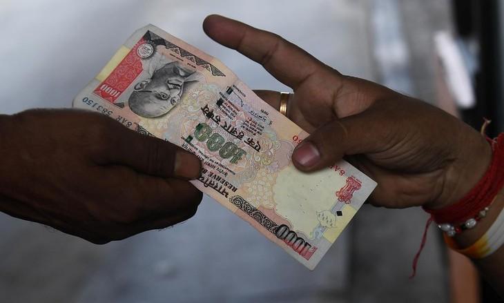 En Inde, 24 milliards de billets démonétisés  - ảnh 1