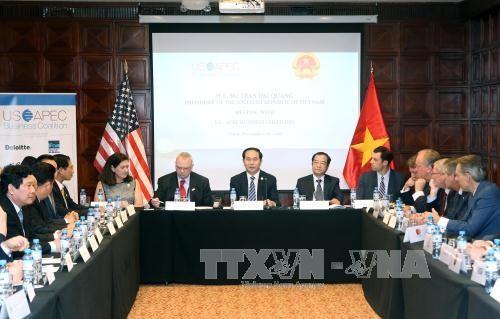 Activités de Tran Dai Quang en marge du 24ème sommet de l'APEC - ảnh 2