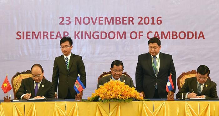 Déclaration commune du 9ème Sommet du Triangle de Développement CLV  - ảnh 1