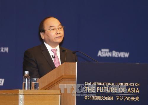 PM Vietnam Nguyen Xuan Phuc menyampaikan pidato pada upacara pembukaan Konferensi ke-23 Masa Depan Asia - ảnh 1