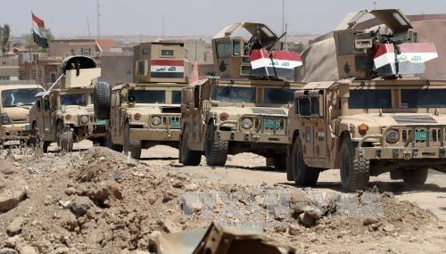 Irak membebaskan satu kawasan luas di kota Mosul sebelah Barat - ảnh 1