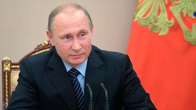 Presiden Rusia memperingatkan akibat dari sanksi-sanksi baru AS - ảnh 1