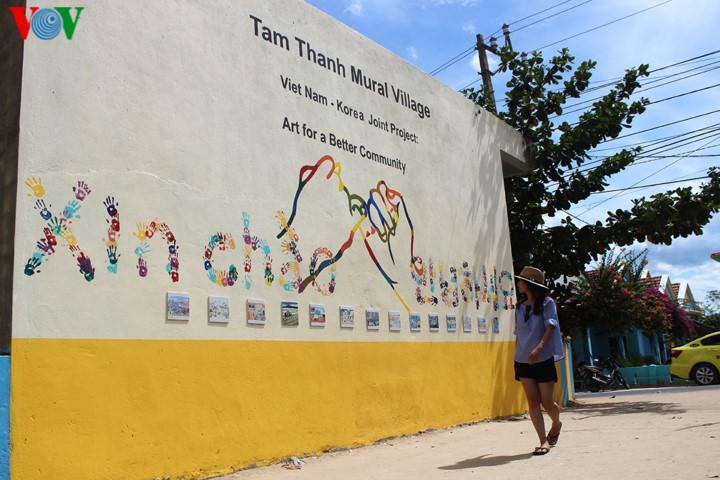หมู่บ้านประมงที่มีการวาดภาพบนผนังแห่งแรกในเวียดนาม - ảnh 1