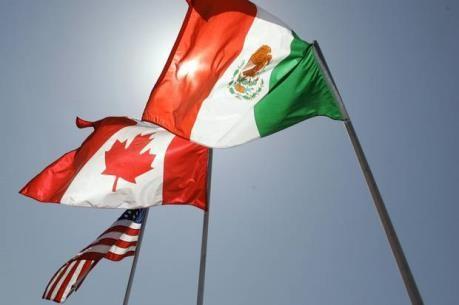 Menetapkan saat melaksanakan  putarna perundingan kembali yang pertama tentang NAFTA - ảnh 1