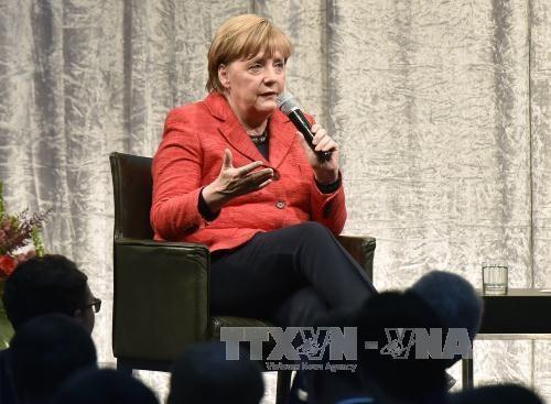 法国总统马克龙会见德国总理默克尔 - ảnh 1