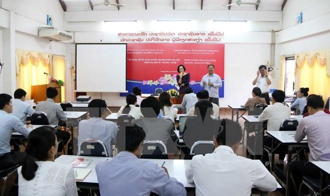 越南与老挝加强媒体新闻合作 - ảnh 1