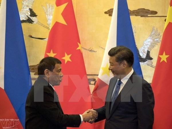 中菲元首通电话讨论双边关系和地区问题 - ảnh 1