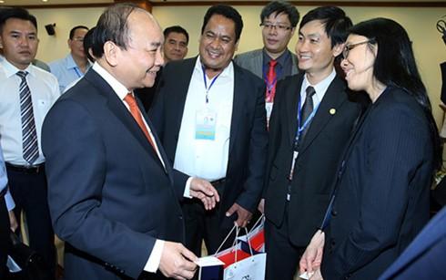 Premierminister Nguyen Xuan Phuc trifft hervorragende Akademiker mit vietnamesischer Abstammung - ảnh 1