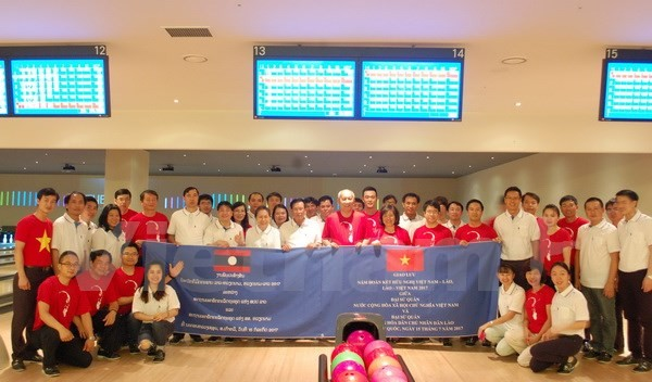 Freundschaftsaustausch zwischen den Botschaften Vietnams und Laos in Südkorea - ảnh 1