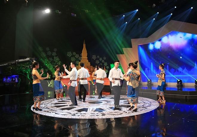 Hoạt động kỷ niệm 55 năm ngày thiết lập quan hệ ngoại giao Việt Nam - Lào - ảnh 1