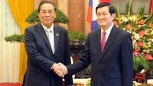 Staatspräsident Truong Tan Sang ist in Vientiane eingetroffen - ảnh 1