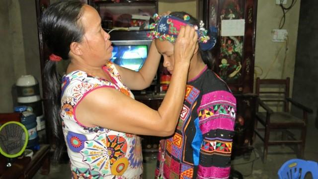 Einzigartige Kulturelemente der Volksgruppe Lo Lo im Kalkplateau Dong Van - ảnh 2