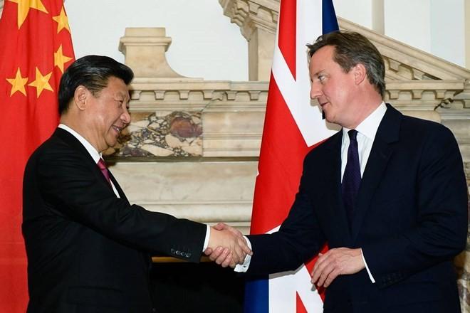 Chinesischer Staatschef führt Gespräch mit britischem Premierminister  - ảnh 1